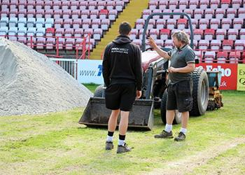 "Exeter City FC's pitch ""now being used to grow crops"" by Deaf Academy students"